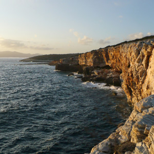 Cliffs off Trypiti beach at sunset time